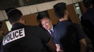 Le minditre de l'Intérieur Gerard Collomb lors d'une visite aux services de police des quartiers nords de Marseille, le 24 Mai 2018.