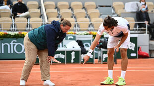 Where? There! France's Pierre-Hugues Herbert checks the line with the umpire during his Roland Garros second round match against Alexander Zverev