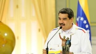 President Nicolas Maduro, shown in this June 5, 2019 photo at his Miraflores Palace in Caracas, blames the country's blackouts on sabotage by the United States and the Venezuelan opposition