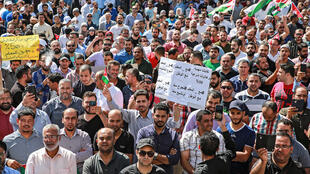 Public school teachers demonstrate demanding pay raises in Jordan's capital Amman in October 2019