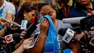 Jergin Dela Cruz Malabanan, daughter of one of the journalists killed in the 2009 Maguindanao Massacre in southern Philippines, speaks to the media before the promulgation of the case in Taguig City, Metro Manila, Philippines, December 19, 2019