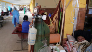 Patients with COVID-19 are treated in the corridor of a hospital in the Amazon city of Iquitos, on May 14, 2020