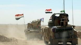 قوات عراقية تحتشد في قاعدة القيارة (60 كلم جنوب الموصل) الاحد
