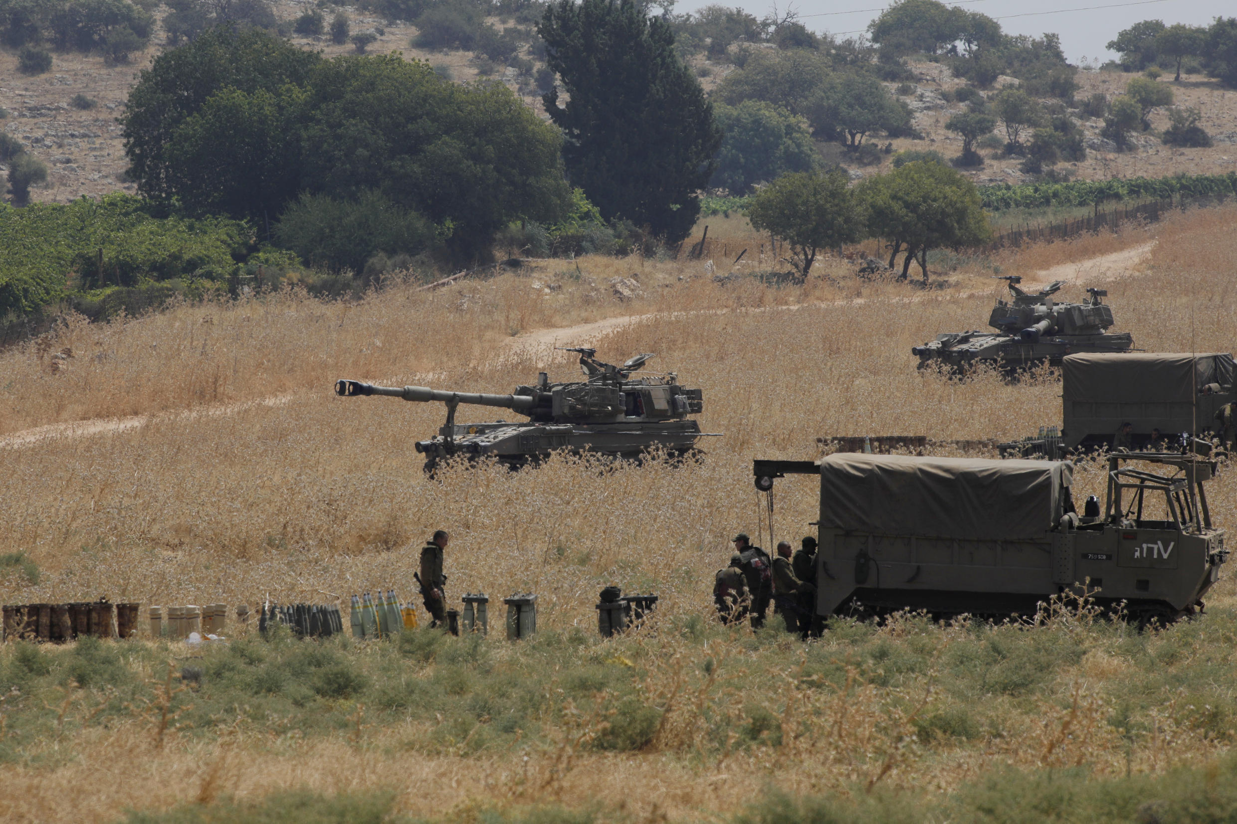 Armoured vehicles and 155 mm self-propelled howitzers deployed in the Upper Galilee in northern Israel on the border with Lebanon on July 27, 2020.