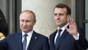 Putin-y-Macron-palacio-eliseo-9-dic-Reuters