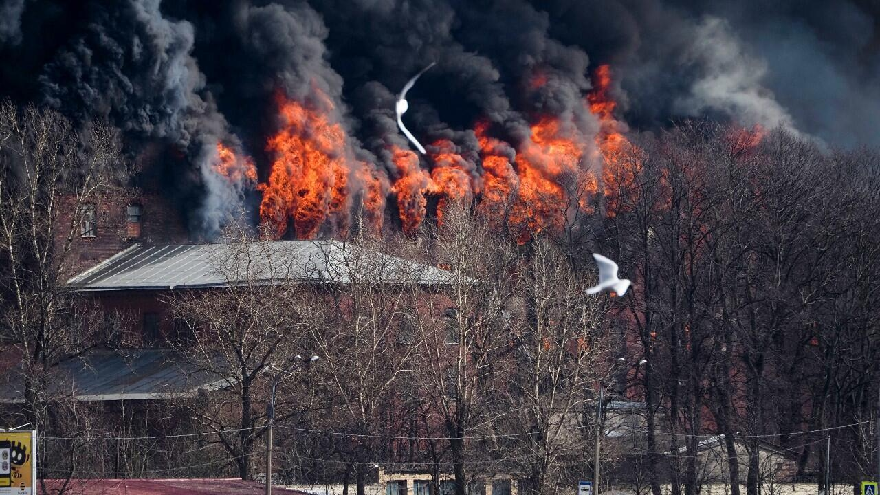 Smoke and flame rise from the Nevskaya Manufaktura textile factory, founded by English merchant J. Thornton in 1841, in St. Petersburg, Russia, on April 12, 2021. The emergencies ministry said the fire had broken out over several floors of the red-brick Nevskaya Manufaktura building on the Oktyabrskaya Embankment of the Neva River.