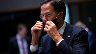 Dutch Prime Minister Mark Rutte takes off his protective mask at an EU summit in Brussels on July 18, 2020.