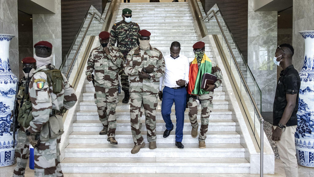 Guinea's junta rules out exile for ousted president as opposition activists return to Conakry