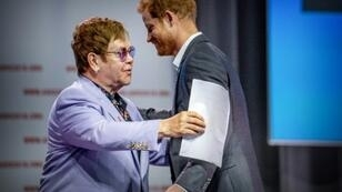 Singer Elton John and Britain's Prince Harry launch a new initiative to fight the stigma around HIV at an AIDS conference in Amsterdam