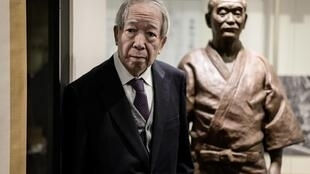 Taketo Kano, a descendant of the Japanese founder of judo Jigoro Kano and chairman of major brewer Kiku-Masamune, stands next to a life-size statue of Jigoro Kano at the Mikage Public Hall in Kobe, Hyogo prefecture