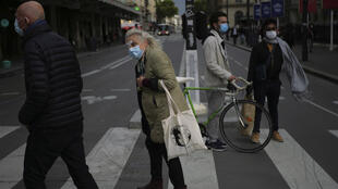 People wear face masks as a precaution against coronavirus in Paris on October 8, 2020.