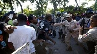 Demonstrators clash with police in Port-au-Prince, on December 13.