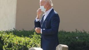 U.S. President-elect Joe Biden leaves after a church service in Wilmington, Delaware, U.S., November 8, 2020.