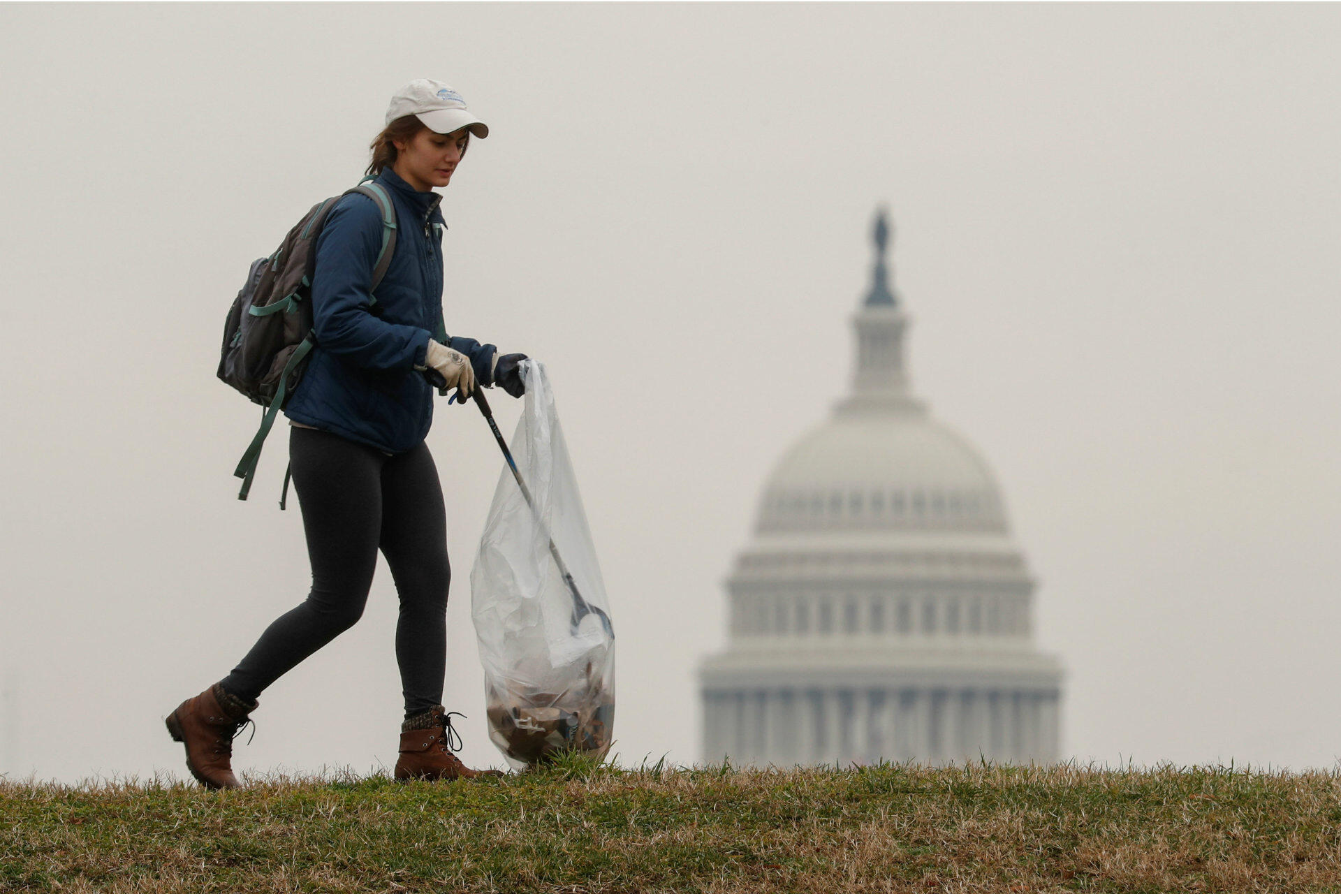 Olivia Anderson of Arlington, VA, joins volunteers, many of whom are furloughed workers, to clean up trash on the National Mall in response to the partial government shutdown in Washington, DC, on January 4, 2019. The current shutdown has not affected three-quarters of the US government, including Defence and the Postal Service, which benefit from secure funding. But 800,000 federal employees have been furloughed or are working without pay. The departments of Homeland Security, Transportation and Interior, which includes the National Park Service, are among those affected, as well as agencies including the Internal Revenue Service, the Environmental Protection Agency and NASA.