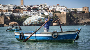 A boatman rows across the Bou Regreg river near the medieval Kasbah of the Udayas between the city of Sale and Morocco's capital Rabat