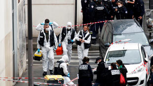 Forensic experts at work at the site of the attack where, on September 25, 2020, a suspect stabbed two people near the former offices of French magazine Charlie Hebdo in Paris, France.