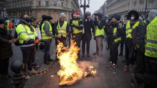 Des Gilets jaunes rassemblés à Paris, le 15décembre2018.