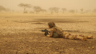 In this photo taken on March 26, 2019, a French soldier is securing a perimeter during a break in a military convoy trip in Mali.