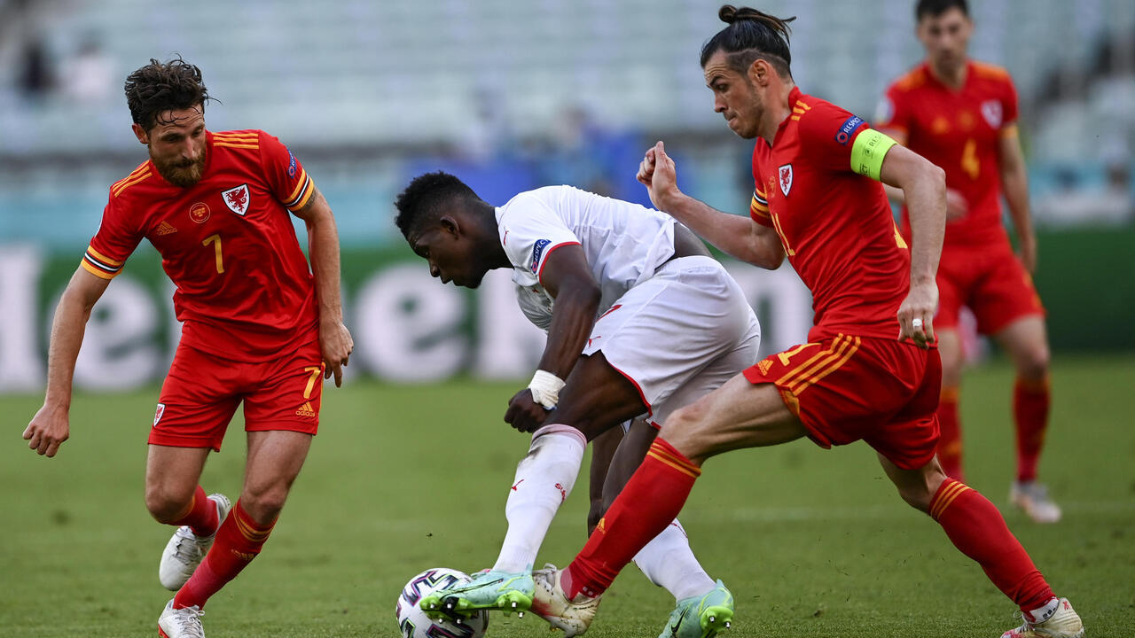 Wales draw with Switzerland, mighty Belgium enter fray