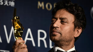 Irrfan Khan poses with a statuette for Best Actor at the 2014 Asian Film Awards
