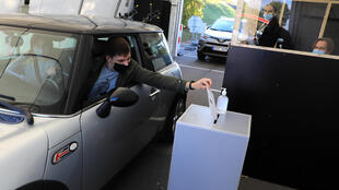 Lithuanians can vote at drive-through polling stations to limit the spread of the coronavirus