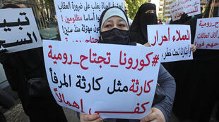 The familiesof detainees in Lebanon's Roumieh prison staged a protest in front of a Beirut courthouse Monday, demanding a general amnesty for their relatives over fears Covid-19 was spreading inside