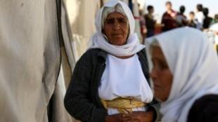 الإيزيديون أقلية قومية ودينية يتركز وجودها خصوصا قرب الحدود السورية في شمال العراق
