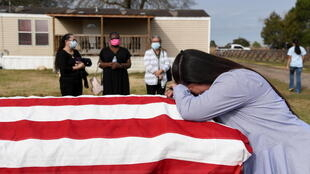 Lila Blanks reacts next to the casket of her husband, Gregory Blanks, 50, who died from complications from the coronavirus disease (Covid-19), ahead of his funeral in San Felipe, Texas, US, January 26, 2021.