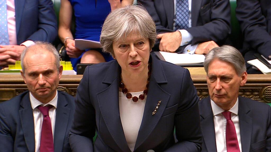 La primera ministra británica Theresa May se dirige a la Cámara de los Comunes sobre la reacción de su gobierno ante el envenenamiento del exagente de inteligencia ruso Sergei Skripal y su hija Yulia en Salisbury, en Londres, el 14 de marzo de 2018.