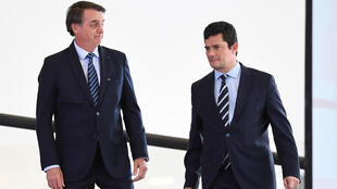 Brazilian President Jair Bolsonaro (L) and his Minister of Justice and Public Security Sergio Moro at Planalto Palace in Brasilia, Brazil, August 29, 2019.