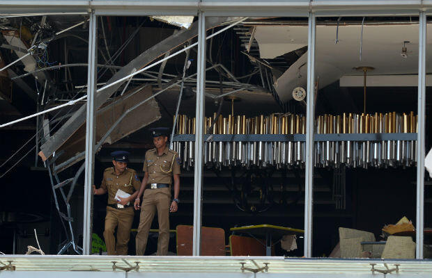 Sri Lankan police at the site of the blast that hit the luxury Shangri-La Hotel in Colombo.