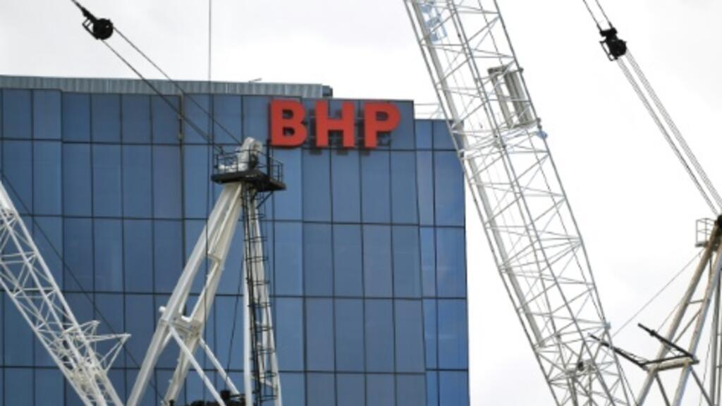 BHP posts lower profits, warns of China trade risk