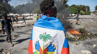 Protesters gather to demand the resignation of Haitian President Jovenel Moïse, who seeks to remain in office until February 2022, in Port-au-Prince on February 7, 2021.