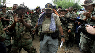 Rodrigo Tovar (C), pictured with his paramilitaries in March 2006 in the Colombian department of Cesar