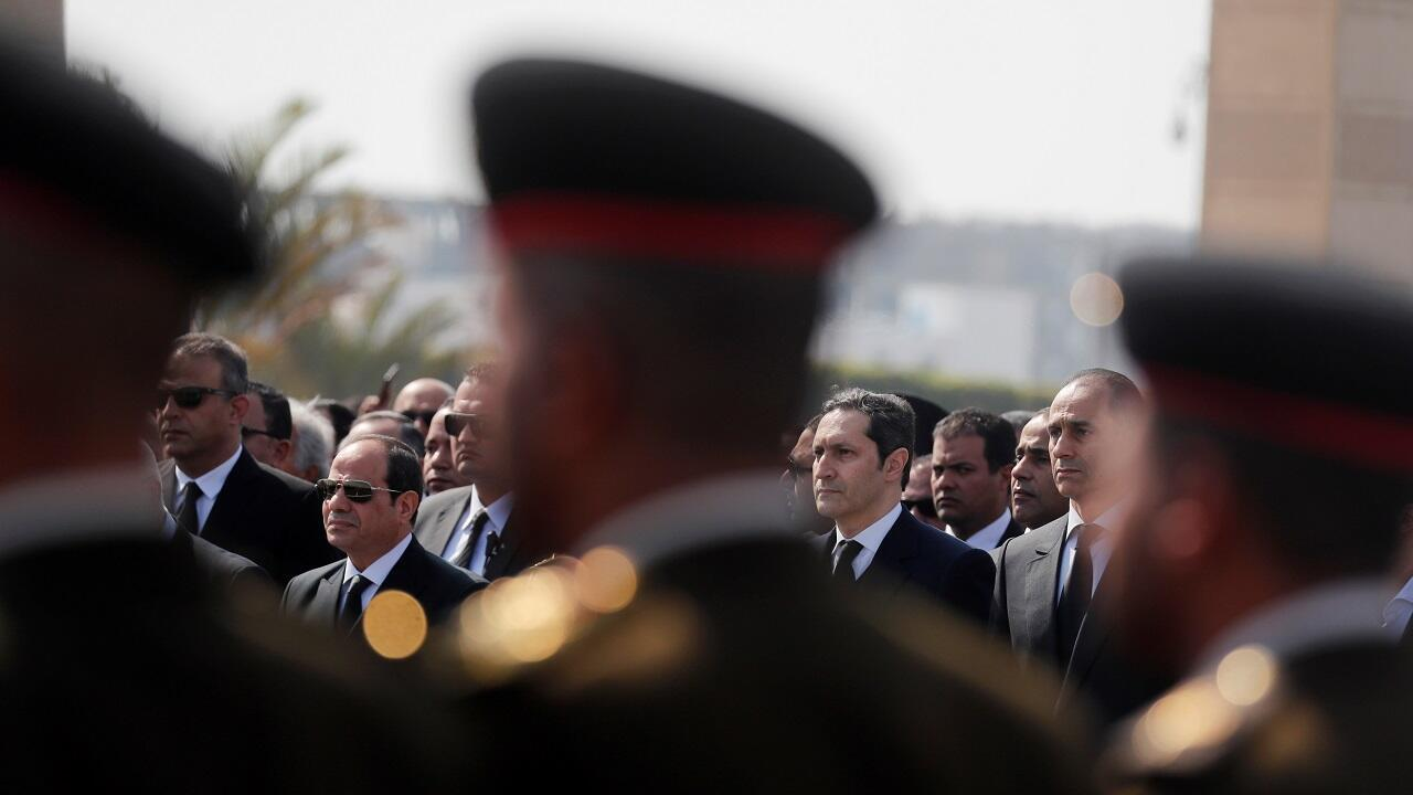 Egyptian President Abdel Fattah el-Sisi and sons of former Egyptian President Hosni Mubarak Alaa and Gamal, attend the funeral of Mubarak east of Cairo, Egypt February 26, 2020. REUTERS OK