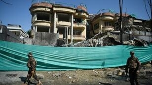 The massive explosion felled trees and toppled dense concrete blast walls on the street outside the Counterpart International compound in Kabul