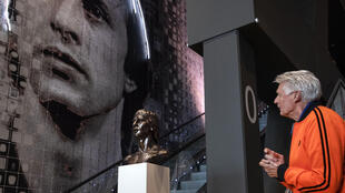 Wim Suurbier looks at a sculpture of former teammate Johan Cruyff at the Johan Cruyff ArenA in Amsterdam in January 2019