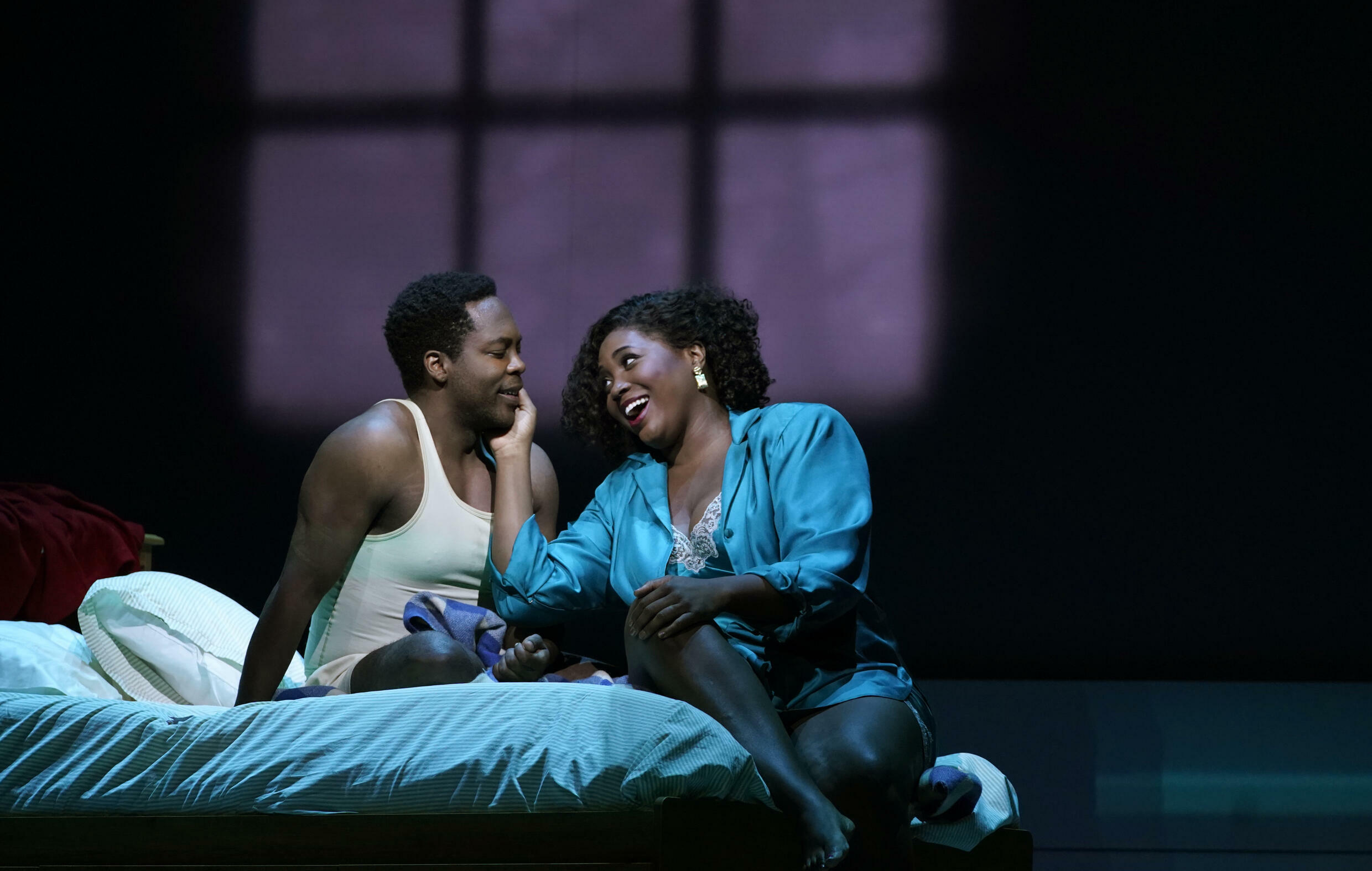 Actors Angel Blue (R) and Will Liverman perform a scene during a rehearsal for Terence Blanchard's
