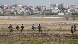 مقاتلون أتراك بالقرب من الحدود التركية السورية، 13 أكتوبر/تشرين الأول 2019.