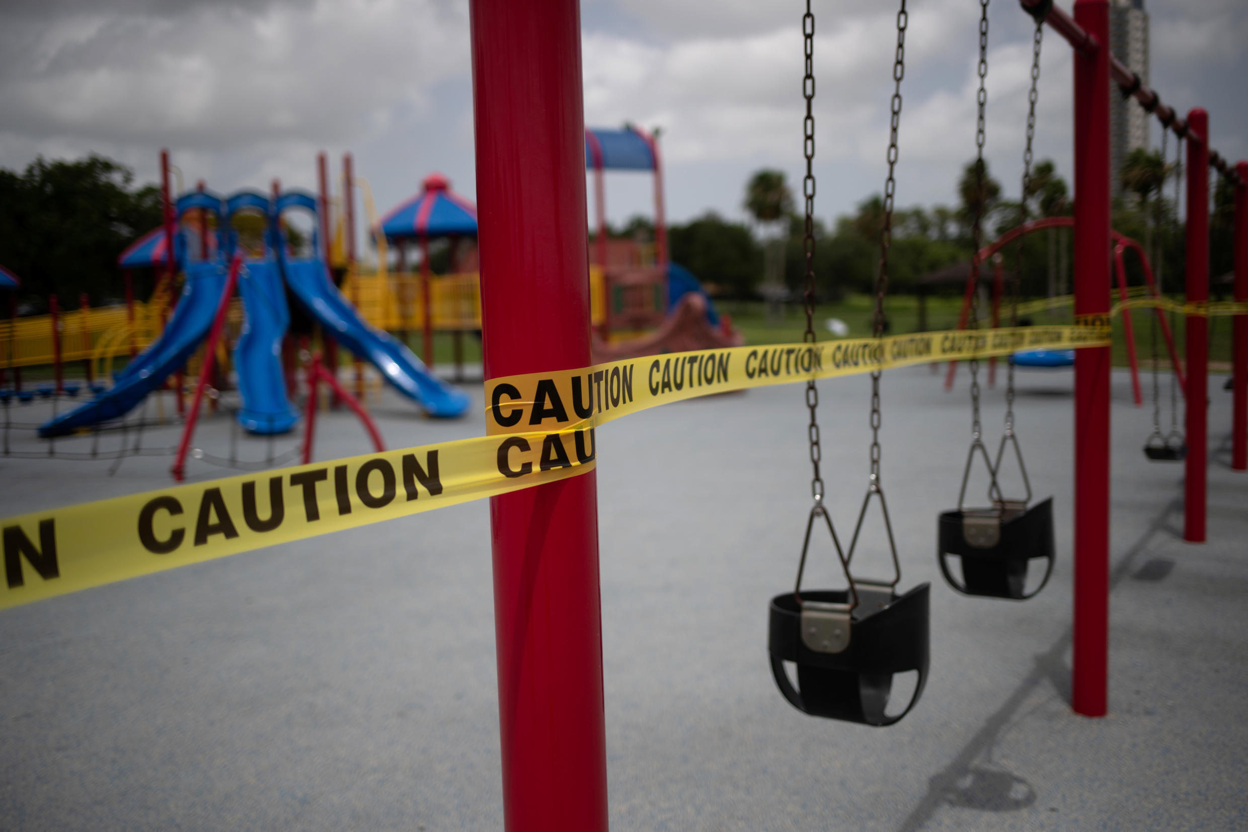 An empty playground surrounded by caution tape in Searbrook, Texas, one of the worst-hit US states, pictured on July 8, 2020.