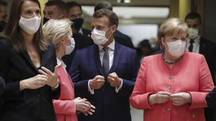President of the European Commission Ursula von der Leyen, French President Emmanuel Macron, Germany's Chancellor Angela Merkel talk prior to their European Union Council in Brussels on July 17, 2020.