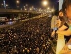 Hong Kong police fire tear gas at protesters targeting Beijing liaison office