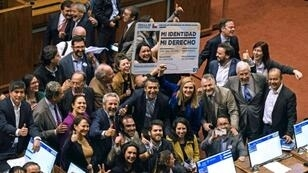 """Chilean deputies for the Frente Amplio party, celebrating in September with a giant fake Chilean Identity card reading """"My identity, my right"""", after voting a gender identity law that allows the change of name and sex in public records from the age of 14: it was signed into law Wednesday by President Sebastian Pinera"""