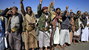Yemeni tribesmen attend a rally denouncing the US designation of the Huthi rebels as a terrorist group in the Huthi-held capital Sanaa on February 4, 2021