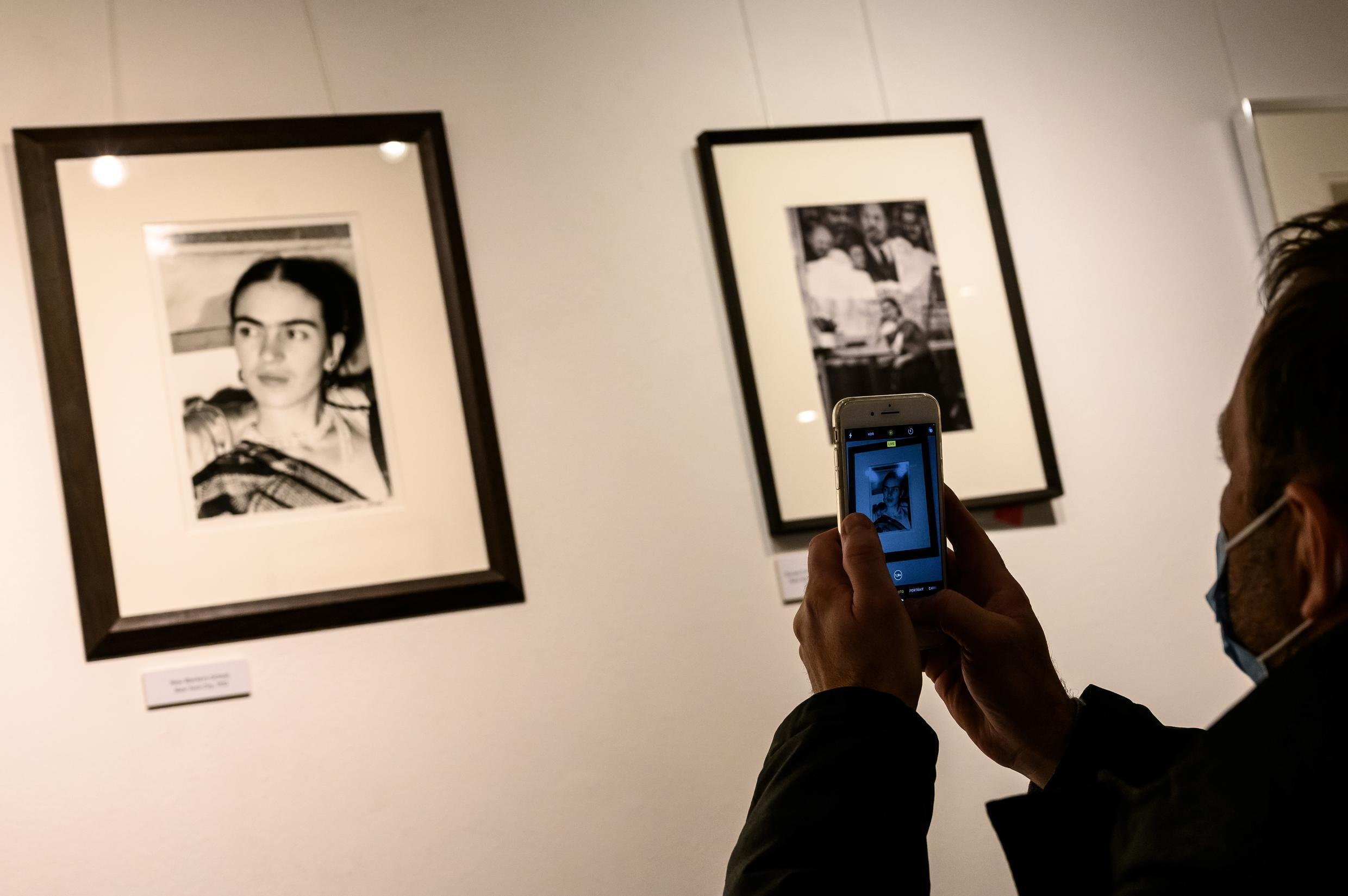 "A man looks at pictures by US artist Lucienne Bloch showing Mexican artist Frida Kahlo displayed as part of the exhibition entitled ""The artist's vision"" on February 6, 2021, in the ""Galerie de l'instant"" in Paris."
