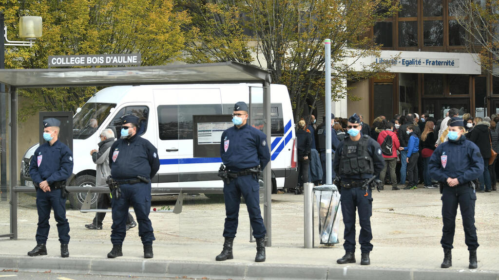 French police raid dozens of targets suspected of extremism after teacher beheaded