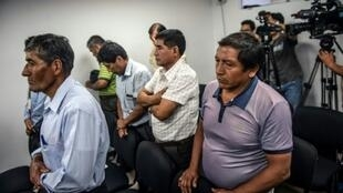 Retired Peruvian military officers appear in court to face charges of rape