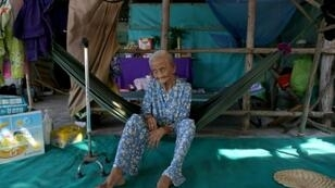 Pham Thi Ca, 99, was offered money to move from her home in Vietnam as authorities hoovered up land for a planned $2.6 billion Japanese-funded coal plant