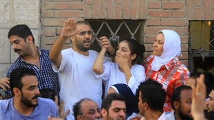 Sanaa Seif and her brother Alaa Abdel Fattah (back row, middle) have both spent time in prison for their activism
