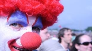 A non-violent clown at the Glastonbury Festival, England, in 2007.